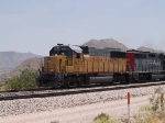 UP 1675 leads a WB local manifest at 12:58pm