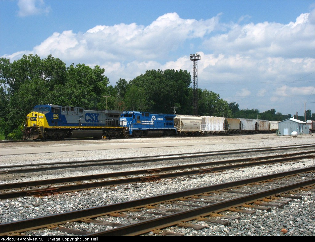 CSX 502 & 5965 doubling Q335 into another track under the humid summer day sky