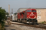 CP 8828 & 8761 rolling eastward under the signal at Godfrey with X500-07