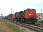 CN 2628 & 2682, repaying horsepower hours to CP, lead X500-18 towards the yard