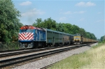Eastbound Push-Mode Metra Commuter Passes Parked Eastbound Coal Train With Its Own DPU Pusher