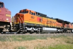 BNSF 882 (C40-8W) with new paint scheme offset by the Warbonnet box