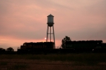 BNSF 6730 (SD40-2) leading Z-CHCLAU past the water tower at Fort Keogh during sunset