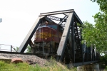 BNSF 8229 (SD75M) peeks its nose off the bridge spanning the Tongue River