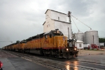 WB UP Freight at Creston,  Illinois,  in the rain