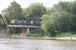 CSX 257 disturbs the peace of the Wabash River as campers look on