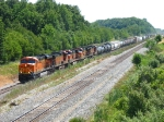 Five BNSF units led by 7552, power Q381 westward