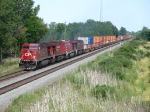 23T accelerating westward behind CP 9716