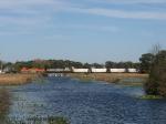 N859-18 crossing the causeway through Syracuse Lake