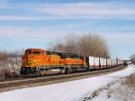 BNSF 538 takes a string of Manufacturers Railway cars west.