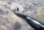 UTAH 9008  Heads Coal Into One of the Kyune Tunnels While an SP Train Makes an Exit