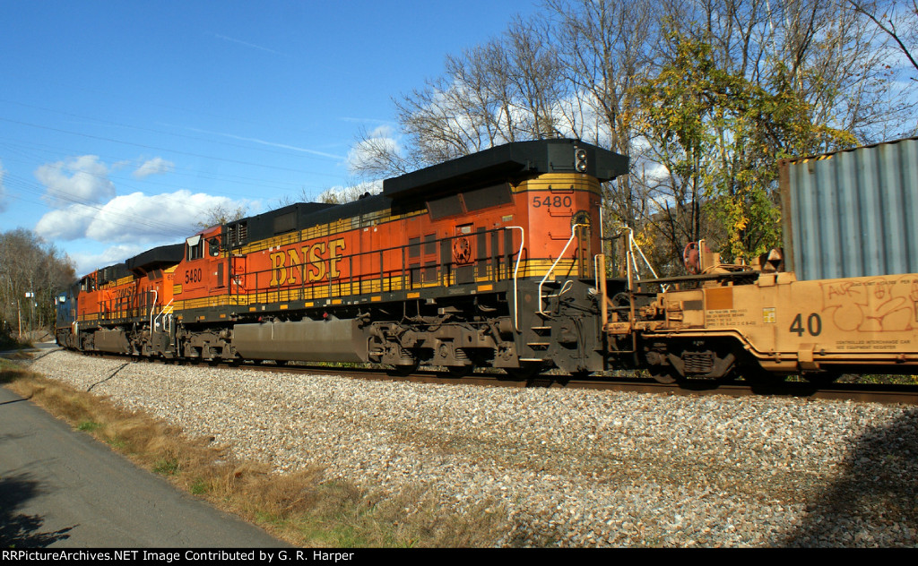 Two BNSF units, 4 and 5 of five, trail on Q13506.