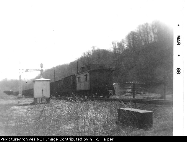 C&O cab 192? EB under the cantilever at the west end of siding