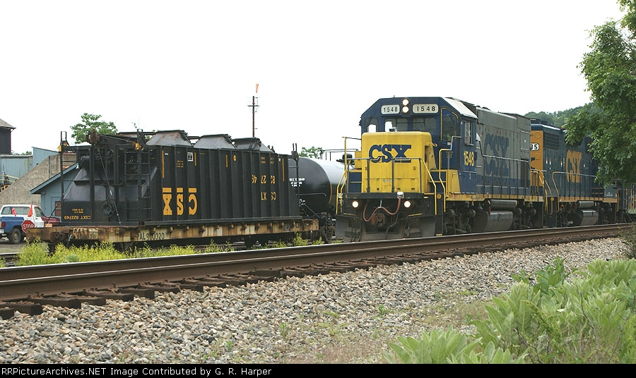 323 - GP15 on the H74421 eases past unusual load at the BRC Rail Car Facility