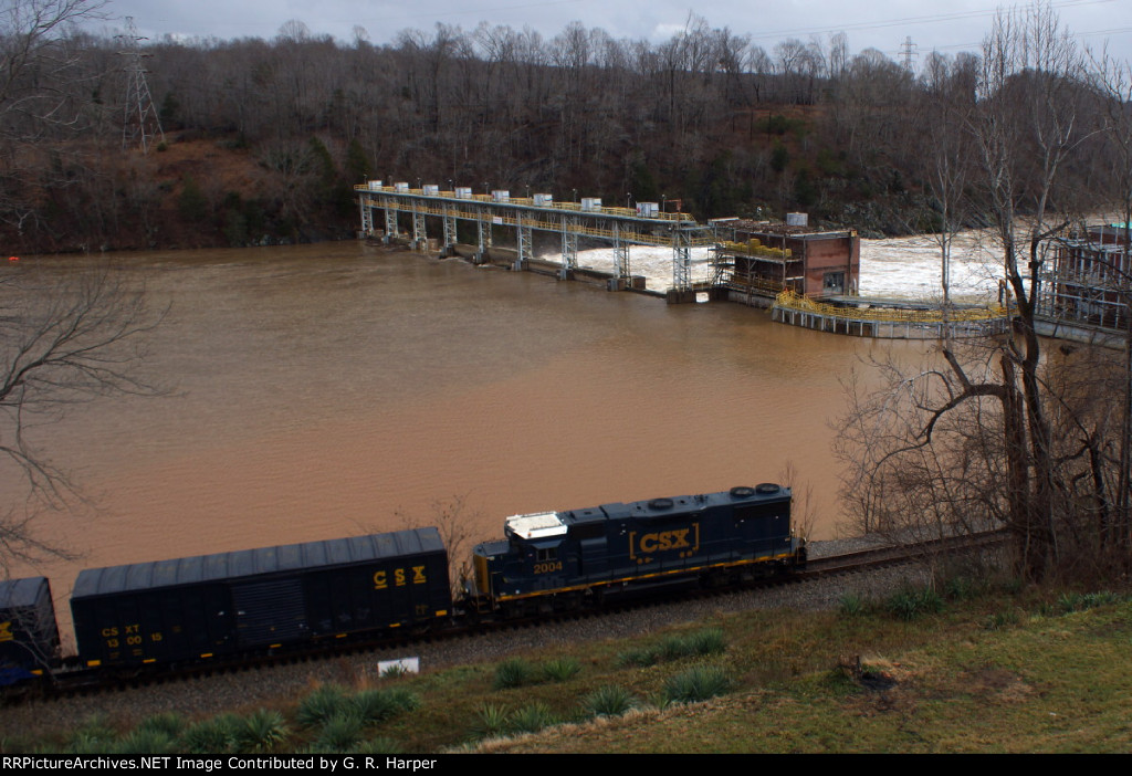 On this, the winter solstice, CSXT 2004 LHF with the H744 local returning from the G-P paper mill in Big Island, VA.  More rain has brought the river up