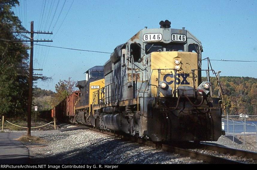 CSX 8146 leads a ballast train