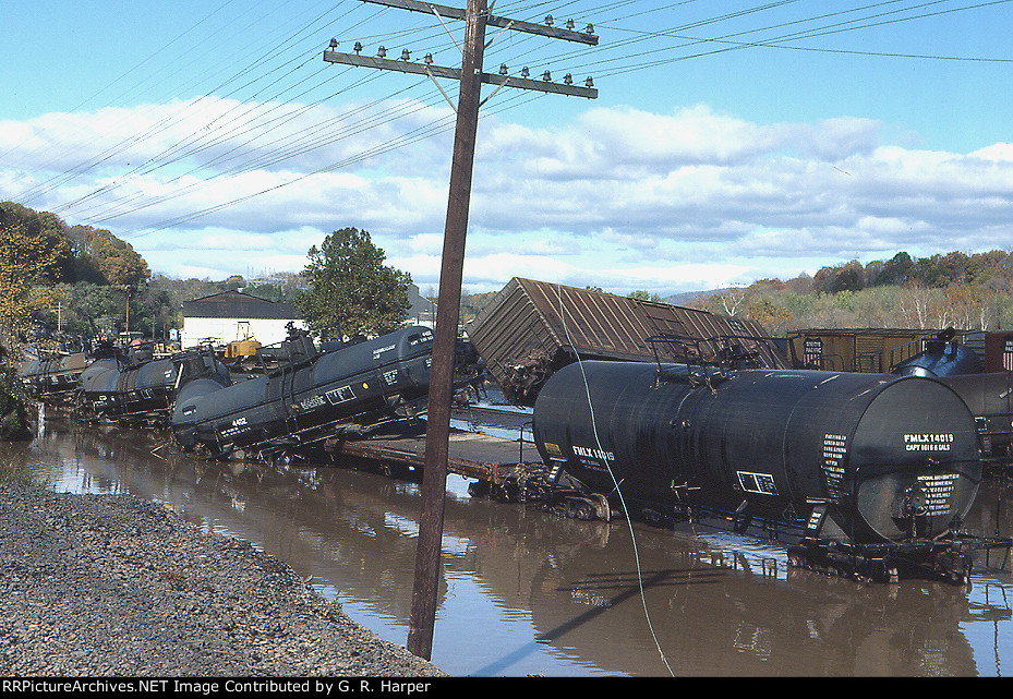 Freight cars askew after having been submerged by the flood the day before