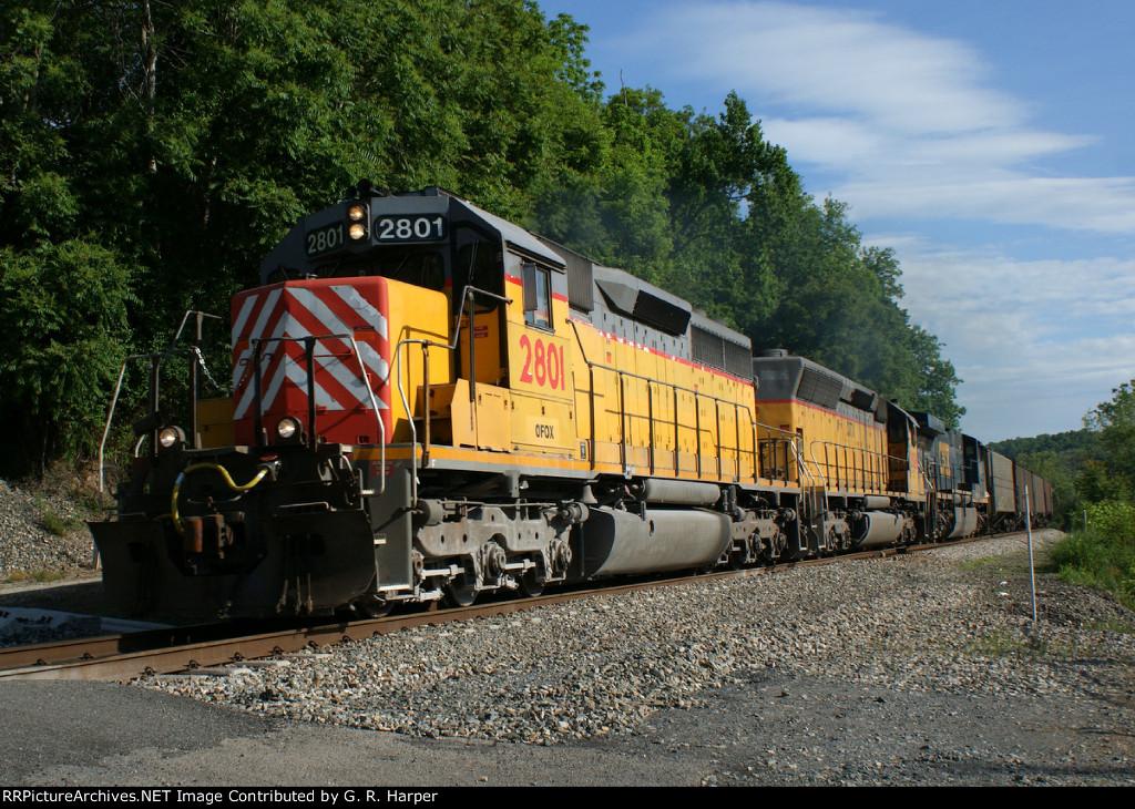 OFOX 2801 leads a grain train past the power plat entrance at Reusens