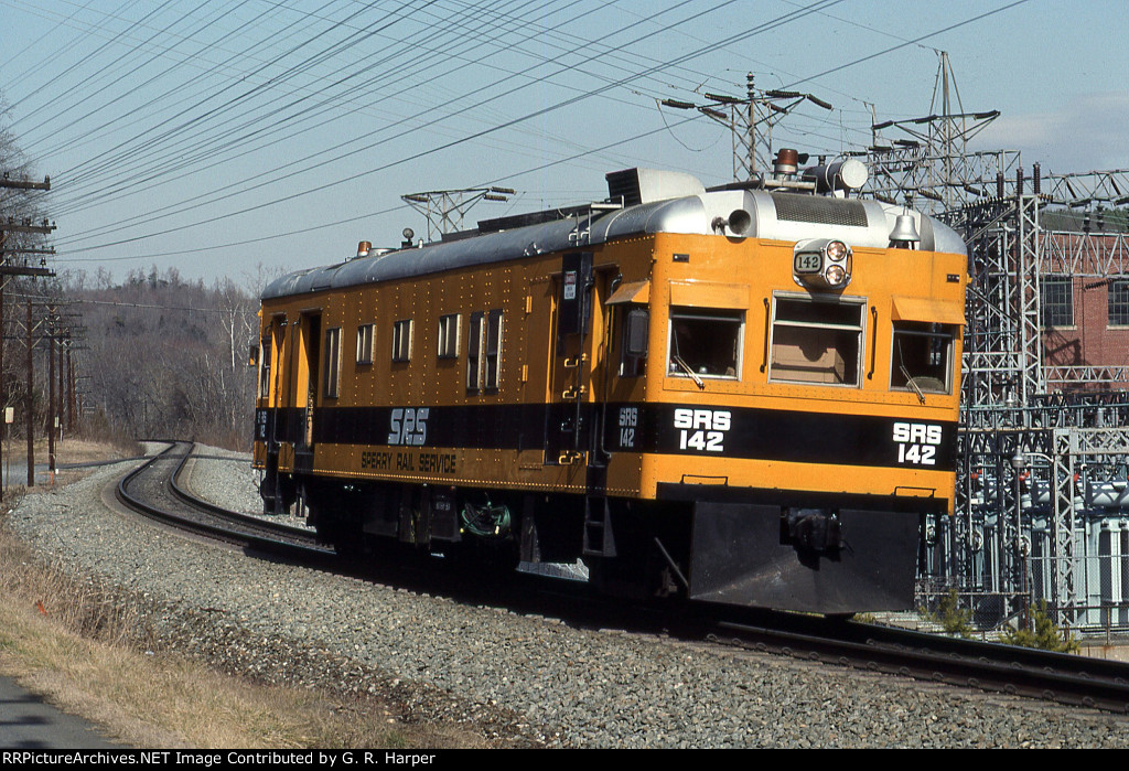 Sperry RAIL car 142 heads east past the hydro plant