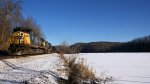 708 - Eastbound coal along a snow-covered, ice-over Reusens Dam Pond