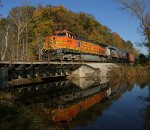 BNSF power with eastbound CSX CBR train K08027 crossing Judith Creek