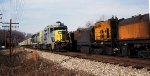 CSXT 2258 with a ballast train in tow passes a Loram rail grinder in the siding at Reusens