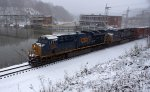 Q30316 heads west in moderate snow.