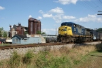 CSX 423 on Q30329 passes the old E. J. Lavino furnace