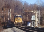 Eastbound coal train passes the westward absolute signals old and new