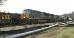 216 - CSXT 5429 on Q30324 passes by EB coal train in siding