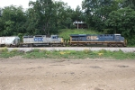 Broadside of CSXT units 785 (tagged) and 8404 (shabby) WB on Q69912 from the drained James River bottom