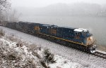 612 - CSXT 3075 leads a train of coal along the James River during an early spring snow storm... on Palm Sunday even!