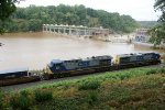 476 - Q13605 heads east past a muddy James River darkened by rain from Tropical Storm Lee