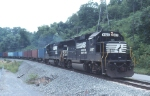 NS 4627 leads the Inland Port train 213 WB on CSXT rail past the dam