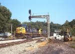 An eastbound passes through signal upgrade work at the west end of the siding