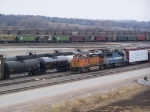 BNSF 4448 & Its Freight Train Sit in the Carling Yard; The Two Coal Trains in the Distance are on the Main Thru-Lines