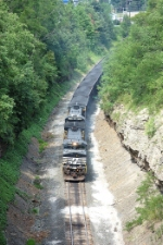 A loaded coal train approaching the New Portage Tunnel
