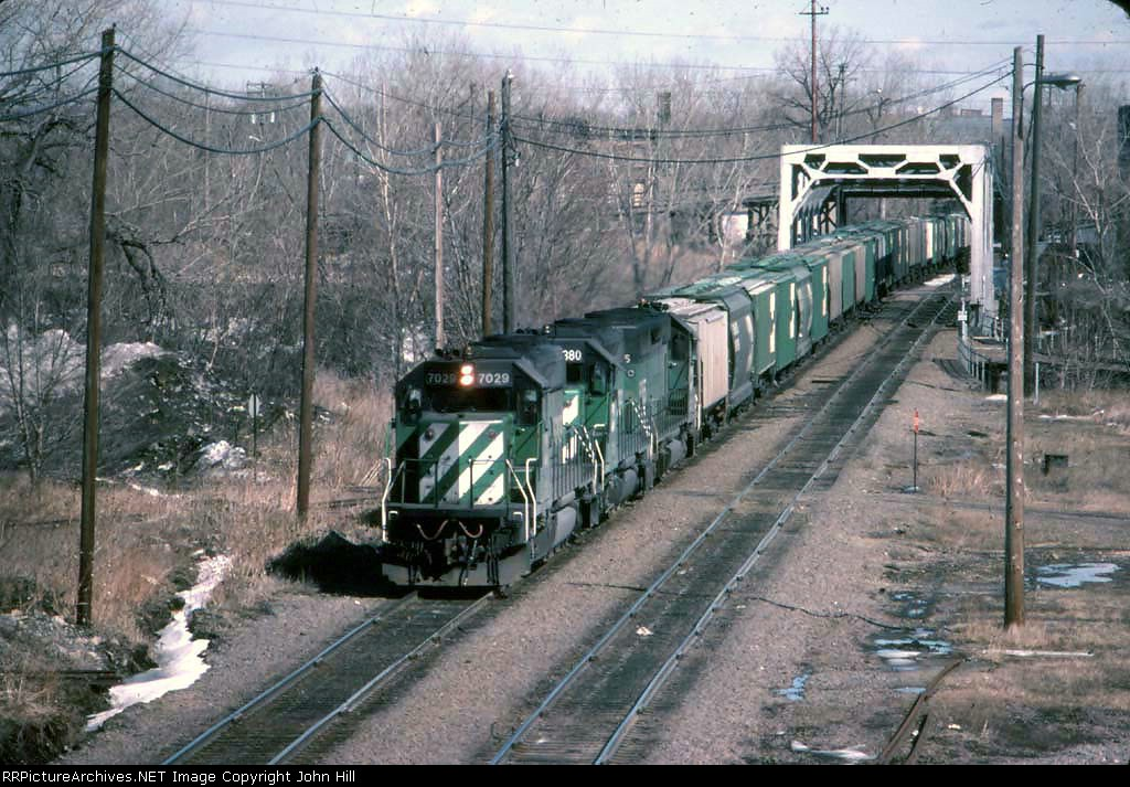 1324-01 Westbound BN freight passing through First Street North on Willmar Line