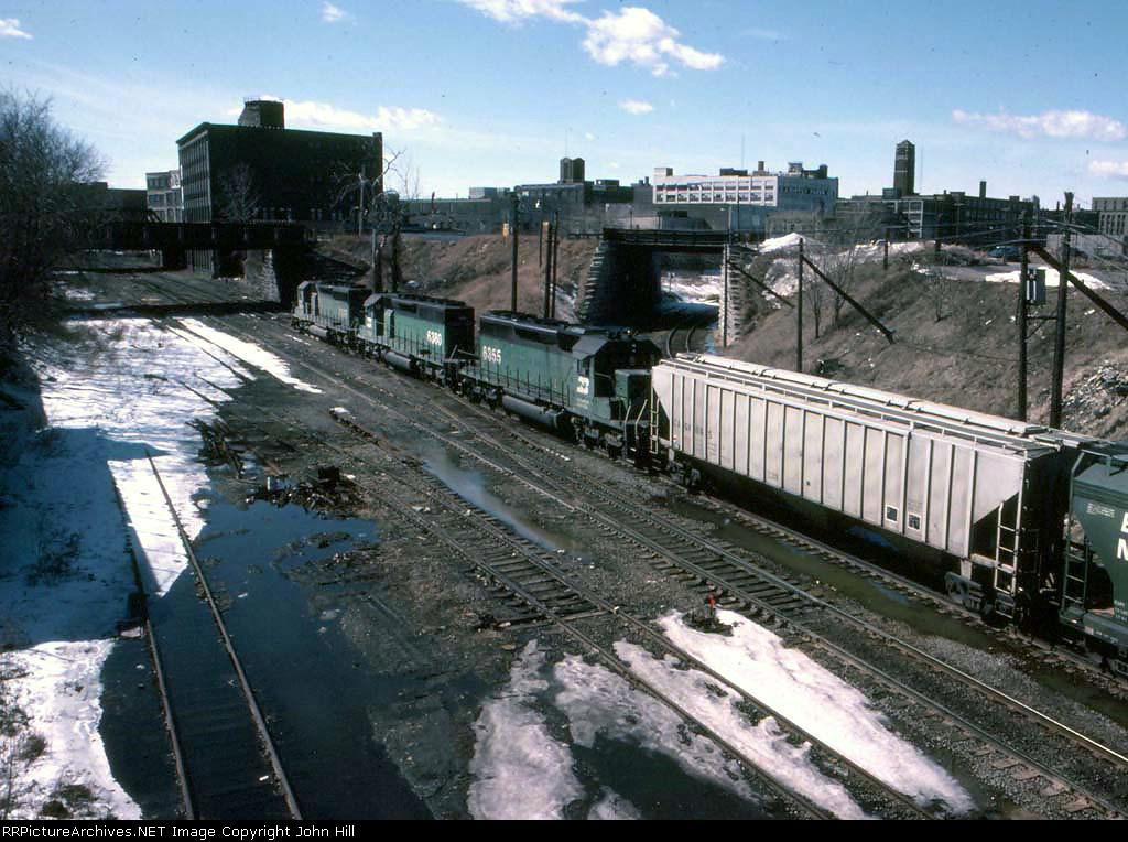 1324-02 Westbound BN freight passing through 1st Street North Jct. on Willmar Line
