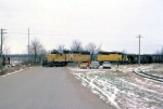 1386-03 C&NW coal empties roll from southbound ex-M&StL to westbound ex-CMO