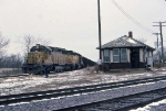 1386-07 C&NW coal empties roll from southbound ex-M&StL to westbound ex-CMO