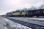 1386-09 C&NW coal empties roll from southbound ex-M&StL to westbound ex-CMO