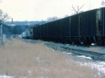 1386-10 C&NW coal empties roll from southbound ex-M&StL to westbound ex-CMO