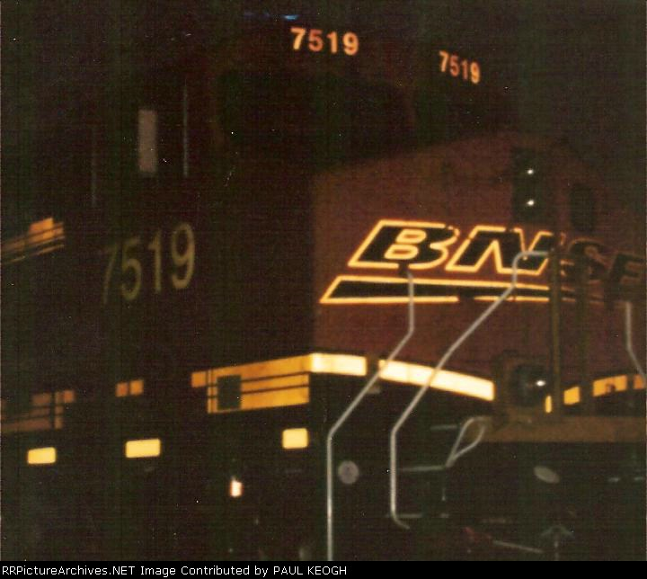 The front right end of BNSF 7519 close up at night.