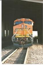 Head on shot of BNSF 7530 under I-25 overpass.
