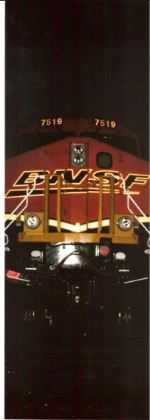 Very close up shot of the business end of BNSF 7519 at night.