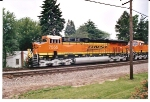 BNSF 7555 and BNSF 7556 roll east past Railroad park, Rochelle, IL.