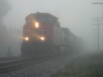 CN 2518, comes out of the fog in the early morning.