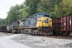 CSX 148 on lead of westbound train passing eastbound ballast train