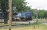 K380 heads east with an ex.Conrail Unit Leading.